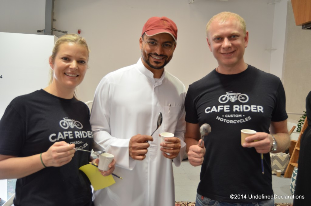 Club members sample coffee and take notes