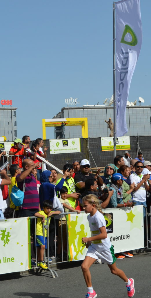 Gwinn Steens, the first prize winner in the Girls 9 to 12 years-old 2KM Solo Category running towards the finish line at the Etisalat Dubai Kids' Run.