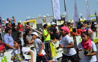 Dubai kids from the 9 to 12 age group category getting fit at an outdoor race at the Dubai Media City Amphitheatre.