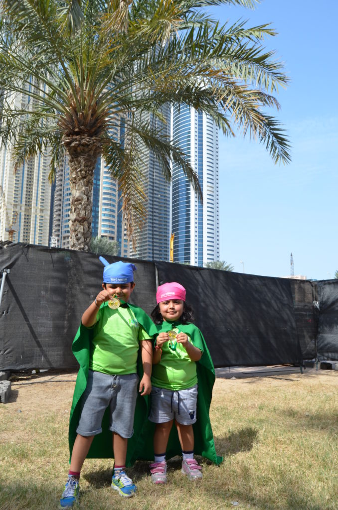 Shriyash, 6 (left) and Shrinya, 3 (right) pose proudly with their medals after the Dubai Kids' Run on Friday. The siblings' mother admits that while her son is very active, her daughter is a little lazy.