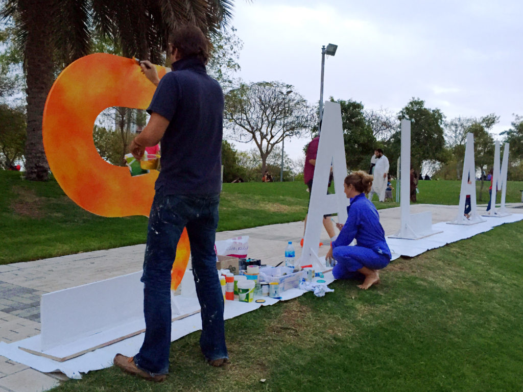 "The word ""Salam"" means peace in Arabic. Artists in Zabeel park painting the letters of the word ""Salam"" ahead of the concert start on Friday."